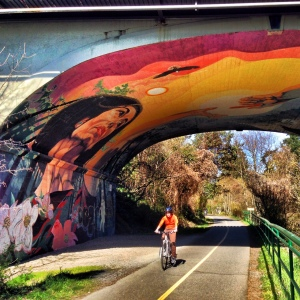 You're on the right path if you go beneath this amazing mural tunnel just after the Selkirk Trestle.